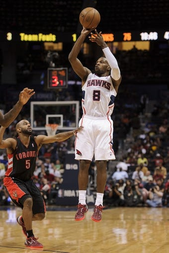 Apr 16, 2013; Atlanta, GA, USA; Atlanta Hawks point guard Shelvin Mack (8) pulls up for a shot over Toronto Raptors point guard John Lucas (5) during the second half at Philips Arena. The Raptors won 113-96. Mandatory Credit: Paul Abell-USA TODAY Sports