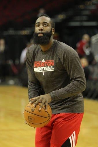 April 14, 2013; Houston, TX, USA; Houston Rockets shooting guard James Harden (13) prepares for a game against the Sacramento Kings at the Toyota Center. Mandatory Credit: Brett Davis-USA TODAY Sports