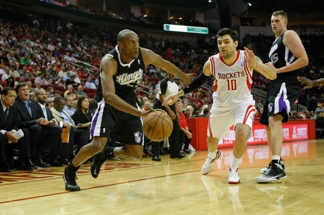 April 14, 2013; Houston, TX, USA; Sacramento Kings small forward Travis Outlaw (25) drives to the basket against the Houston Rockets in the fourth quarter at the Toyota Center. The Rockets defeated the Kings 121-100. Mandatory Credit: Brett Davis-USA TODAY Sports