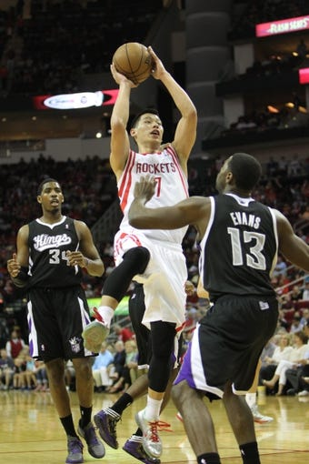 April 14, 2013; Houston, TX, USA; Houston Rockets point guard Jeremy Lin (7) takes a shot against the Sacramento Kings in the first quarter at the Toyota Center. Mandatory Credit: Brett Davis-USA TODAY Sports