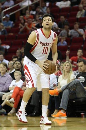 April 14, 2013; Houston, TX, USA; Houston Rockets shooting guard Carlos Delfino (10) takes a shot against the Sacramento Kings in the first quarter at the Toyota Center. Mandatory Credit: Brett Davis-USA TODAY Sports