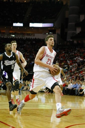 April 14, 2013; Houston, TX, USA; Houston Rockets small forward Chandler Parsons (25) drives to the basket against the Sacramento Kings in the second quarter at the Toyota Center. Mandatory Credit: Brett Davis-USA TODAY Sports