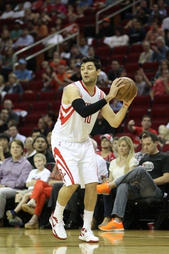 April 14, 2013; Houston, TX, USA; Houston Rockets shooting guard Carlos Delfino (10) in action against the Sacramento Kings in the first quarter at the Toyota Center. Mandatory Credit: Brett Davis-USA TODAY Sports