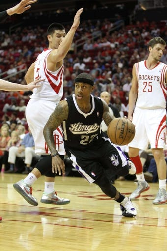 April 14, 2013; Houston, TX, USA; Sacramento Kings point guard Isaiah Thomas (22) drives to the basket against the Houston Rockets in the third quarter at the Toyota Center. The Rockets defeated the Kings 121-100. Mandatory Credit: Brett Davis-USA TODAY Sports