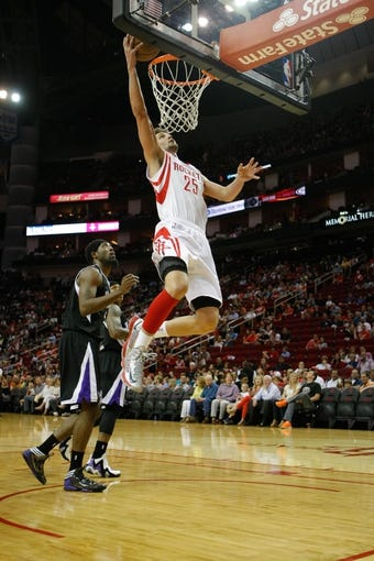 April 14, 2013; Houston, TX, USA; Houston Rockets small forward Chandler Parsons (25) takes a shot against the Sacramento Kings in the first quarter at the Toyota Center. Mandatory Credit: Brett Davis-USA TODAY Sports