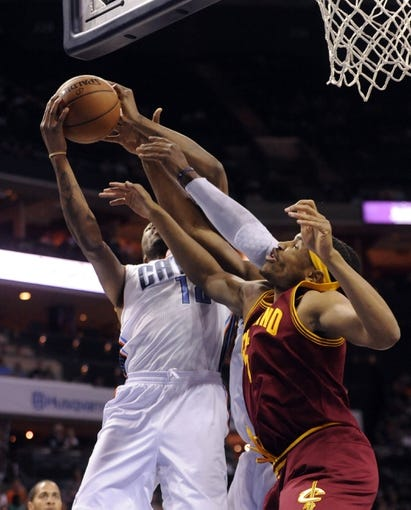 April 17, 2013; Charlotte, NC, USA; Charlotte Bobcats forward Tyrus Thomas (12) and Cleveland Cavaliers forward Kevin Jones (5) fight for a rebound during the game at Time Warner Cable Arena. Mandatory Credit: Sam Sharpe-USA TODAY Sports