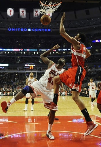 Apr 17, 2013; Chicago, IL, USA;  Chicago Bulls center Nazr Mohammed (48) and Washington Wizards shooting guard Garrett Temple (17) go up for a rebound during the first half at the United Center. Mandatory Credit: David Banks-USA TODAY Sports