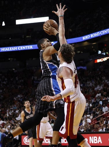Apr 17, 2013; Miami, FL, USA; Miami Heat shooting guard Mike Miller (13) defends a shot by Orlando Magic small forward Tobias Harris (12) in the first quarter at the American Airlines Arena.  Mandatory Credit: Robert Mayer-USA TODAY Sports