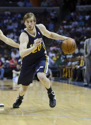 Apr 17, 2013; Memphis, TN, USA;  Utah Jazz shooting guard Gordon Hayward (20) drives to the basket during the game against the Memphis Grizzlies at FedEx Forum.  Mandatory Credit: Spruce Derden   USA TODAY Sports
