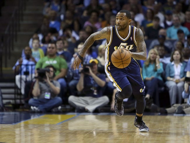Apr 17, 2013; Memphis, TN, USA;  Utah Jazz point guard Mo Williams (5) brings the ball up court during the game against the Memphis Grizzlies at FedEx Forum.  Mandatory Credit: Spruce Derden   USA TODAY Sports