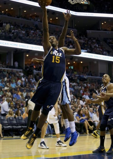 Apr 17, 2013; Memphis, TN, USA;  Utah Jazz power forward Derrick Favors (15) shoots the ball during the game against the Memphis Grizzlies at FedEx Forum.  Mandatory Credit: Spruce Derden   USA TODAY Sports