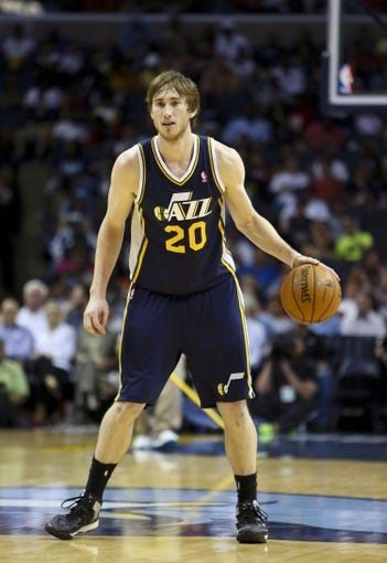 Apr 17, 2013; Memphis, TN, USA;  Utah Jazz shooting guard Gordon Hayward (20) brings the ball up court during the game against the Memphis Grizzlies at FedEx Forum.  Mandatory Credit: Spruce Derden   USA TODAY Sports