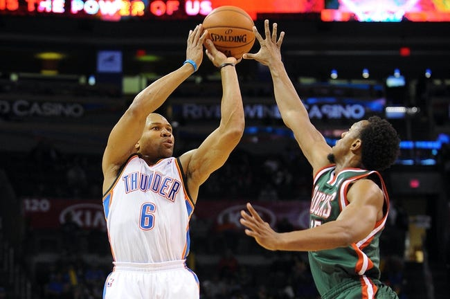 Apr 17, 2013; Oklahoma City, OK, USA; Oklahoma City Thunder guard Derek Fisher (6) attempts a shot against Milwaukee Bucks guard Ish Smith (15) during the second half at Chesapeake Energy Arena. Mandatory Credit: Mark D. Smith-USA TODAY Sports