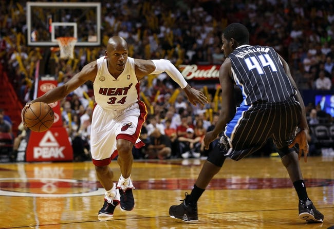 Apr 17, 2013; Miami, FL, USA; Miami Heat shooting guard Ray Allen (34) drives to the basket against Orlando Magic power forward Andrew Nicholson (44) in the second half at the American Airlines Arena. The Heat won 105-93.  Mandatory Credit: Robert Mayer-USA TODAY Sports