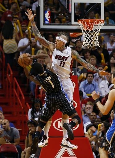 Apr 17, 2013; Miami, FL, USA; Miami Heat power forward Chris Andersen (11) blocks the shot by Orlando Magic shooting guard Doron Lamb (1) in the second half at the American Airlines Arena. The Heat won 105-93.  Mandatory Credit: Robert Mayer-USA TODAY Sports