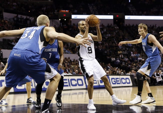 Apr 17, 2013; San Antonio, TX, USA; San Antonio Spurs guard Tony Parker (9) passes the ball against the Minnesota Timberwolves during the first half at the AT&T Center. Mandatory Credit: Soobum Im-USA TODAY Sports