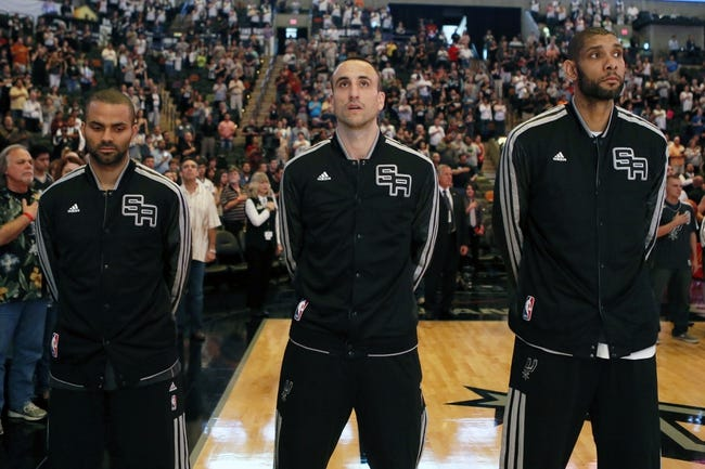 Apr 17, 2013; San Antonio, TX, USA; San Antonio Spurs guard Tony Parker (left), and Manu Ginobili (center), and forward Tim Duncan (right) during the national anthem against the Minnesota Timberwolves at the AT&T Center. Mandatory Credit: Soobum Im-USA TODAY Sports