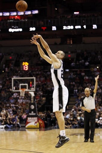 Apr 17, 2013; San Antonio, TX, USA; San Antonio Spurs guard Manu Ginobili (20) shoots during the first half against the Minnesota Timberwolves at the AT&T Center. Mandatory Credit: Soobum Im-USA TODAY Sports
