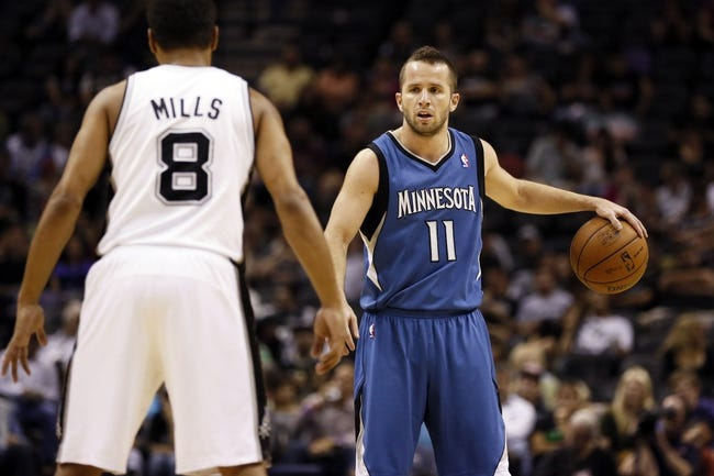 Apr 17, 2013; San Antonio, TX, USA; Minnesota Timberwolves  guard Jose Barea (11) is defended by San Antonio Spurs guard Patrick Mills (8) during the second half at the AT&T Center. The Timberwolves won 108-95.  Mandatory Credit: Soobum Im-USA TODAY Sports