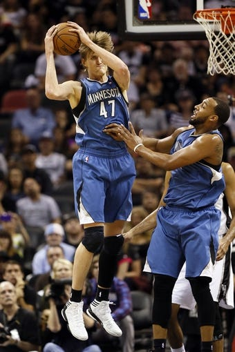 Apr 17, 2013; San Antonio, TX, USA; Minnesota Timberwolves  forward Andrei Kirilenko (47) grabs a rebound during the first half against the San Antonio Spurs at the AT&T Center. Mandatory Credit: Soobum Im-USA TODAY Sports