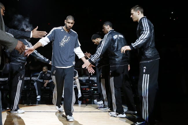 Apr 17, 2013; San Antonio, TX, USA; San Antonio Spurs forward Tim Duncan (21) during player introductions before the game against the Minnesota Timberwolves at the AT&T Center. Mandatory Credit: Soobum Im-USA TODAY Sports