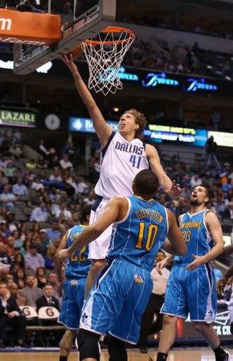 Apr 17, 2013; Dallas, TX, USA; Dallas Mavericks forward Dirk Nowitzki (41) shoots against the New Orleans Hornets at American Airlines Center. Mandatory Credit: Matthew Emmons-USA TODAY Sports
