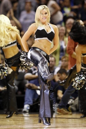 Apr 17, 2013; San Antonio, TX, USA; San Antonio Spurs cheerleader performs during the second half against the Minnesota Timberwolves  at the AT&T Center. The Timberwolves won 108-95.  Mandatory Credit: Soobum Im-USA TODAY Sports