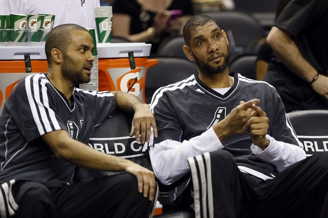 Apr 17, 2013; San Antonio, TX, USA; San Antonio Spurs guard Tony Parker (left) talks with Tim Duncan (right) before the game against the Minnesota Timberwolves at the AT&T Center. Mandatory Credit: Soobum Im-USA TODAY Sports