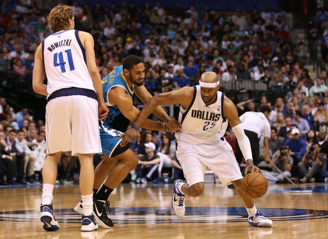 Apr 17, 2013; Dallas, TX, USA; Dallas Mavericks guard Vince Carter (25) drives off a pick set by forward Dirk Nowitzki (41) against New Orleans Hornets guard Xavier Henry (4) at American Airlines Center. Mandatory Credit: Matthew Emmons-USA TODAY Sports
