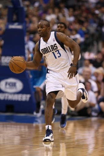 Apr 17, 2013; Dallas, TX, USA; Dallas Mavericks guard Mike James (13) drives against the New Orleans Hornets at American Airlines Center. Mandatory Credit: Matthew Emmons-USA TODAY Sports