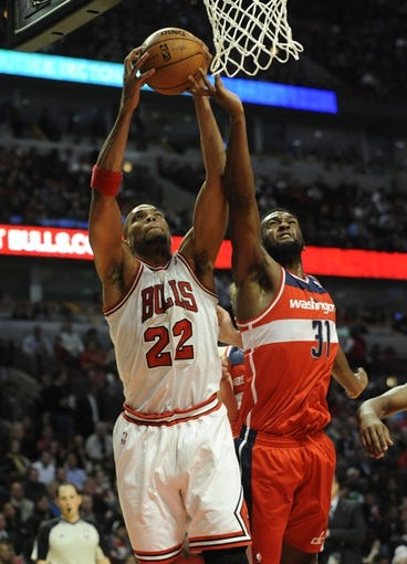 Apr 17, 2013; Chicago, IL, USA;  Chicago Bulls power forward Taj Gibson (22) and Washington Wizards small forward Chris Singleton (31) go for the ball during the first half at the United Center. Mandatory Credit: David Banks-USA TODAY Sports