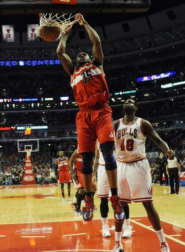 Apr 17, 2013; Chicago, IL, USA;  Washington Wizards power forward Trevor Booker (35) dunks over Chicago Bulls center Nazr Mohammed (48) during the second half at the United Center. The Chicago Bulls defeated the Washington Wizards 95-92. Mandatory Credit: David Banks-USA TODAY Sports