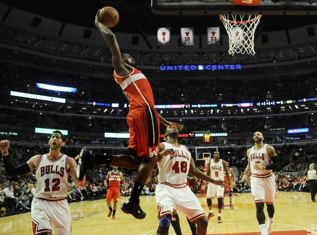 Apr 17, 2013; Chicago, IL, USA;  Washington Wizards small forward Chris Singleton (31) shoots over Chicago Bulls center Nazr Mohammed (48) and  shooting guard Kirk Hinrich (12) during the second half at the United Center. The Chicago Bulls defeated the Washington Wizards 95-92. Mandatory Credit: David Banks-USA TODAY Sports
