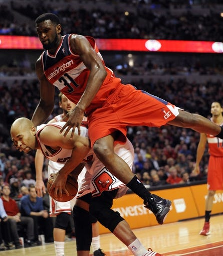 Apr 17, 2013; Chicago, IL, USA; Chicago Bulls power forward Taj Gibson (22) is fouled by Washington Wizards small forward Chris Singleton (31) during the second half at the United Center. The Chicago Bulls defeated the Washington Wizards 95-92. Mandatory Credit: David Banks-USA TODAY Sports