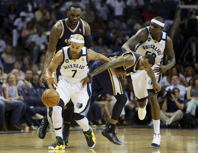 Apr 17, 2013; Memphis, TN, USA;  Memphis Grizzlies point guard Jerryd Bayless (7) struggles to keep the ball away from Utah Jazz point guard Mo Williams (5) during the game at FedEx Forum.  The Memphis Grizzlies defeated the Utah Jazz 86-70.  Mandatory Credit: Spruce Derden   USA TODAY Sports