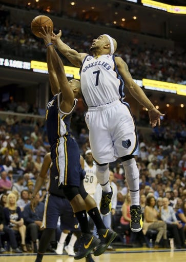 Apr 17, 2013; Memphis, TN, USA;  Memphis Grizzlies point guard Jerryd Bayless (7) and Utah Jazz point guard Randy Foye (8) go up for the rebound during the game at FedEx Forum.  The Memphis Grizzlies defeated the Utah Jazz 86-70.  Mandatory Credit: Spruce Derden   USA TODAY Sports