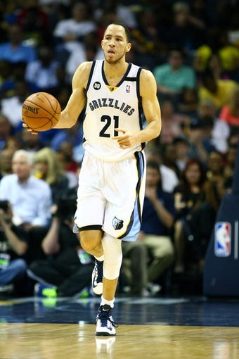 Apr 17, 2013; Memphis, TN, USA;  Memphis Grizzlies small forward Tayshaun Prince (21) brings the ball up court during the game against the Utah Jazz at FedEx Forum.  The Memphis Grizzlies defeated the Utah Jazz 86-70.  Mandatory Credit: Spruce Derden   USA TODAY Sports