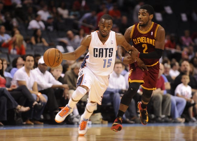 April 17, 2013; Charlotte, NC, USA; Charlotte Bobcats guard Kemba Walker (15) drives past Cleveland Cavaliers guard Kyrie Irving (2) during the game at Time Warner Cable Arena. Bobcats win 105-98. Mandatory Credit: Sam Sharpe-USA TODAY Sports