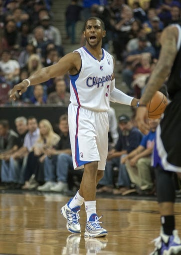 Apr 17, 2013; Sacramento, CA, USA; Los Angeles Clippers point guard Chris Paul (3) directs the offense against the Sacramento Kings during the first quarter at the Sleep Train Arena. Mandatory Credit: Ed Szczepanski-USA TODAY Sports