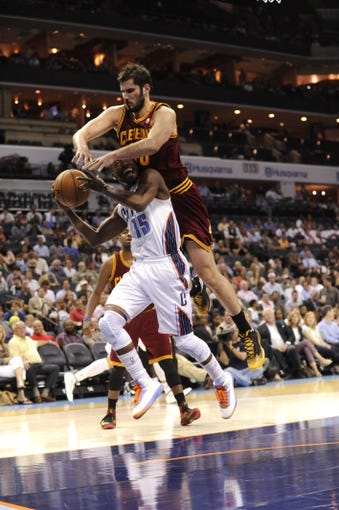 April 17, 2013; Charlotte, NC, USA; Charlotte Bobcats guard Kemba Walker (15) looks to shoot as he is fouled by Cleveland Cavaliers forward Omri Casspi (36) during the game at Time Warner Cable Arena. Bobcats win 105-98. Mandatory Credit: Sam Sharpe-USA TODAY Sports