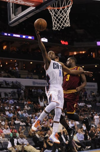 April 17, 2013; Charlotte, NC, USA; Charlotte Bobcats guard Kemba Walker (15) drives to the basket as he is defended by Cleveland Cavaliers guard Kyrie Irving (2) during the game at Time Warner Cable Arena. Bobcats win 105-98. Mandatory Credit: Sam Sharpe-USA TODAY Sports