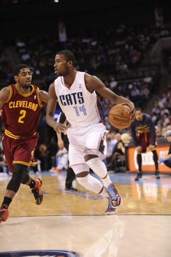 April 17, 2013; Charlotte, NC, USA; Charlotte Bobcats forward Michael Kidd-Gilchrist (14) drives past Cleveland Cavaliers guard Kyrie Irving (2) during the game at Time Warner Cable Arena. Bobcats win 105-98. Mandatory Credit: Sam Sharpe-USA TODAY Sports