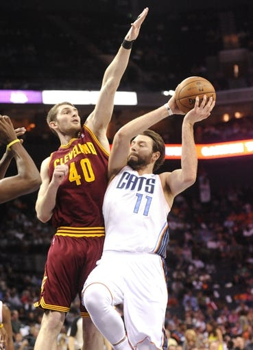 April 17, 2013; Charlotte, NC, USA; Charlotte Bobcats forward Josh McRoberts (11) drives to the basket as he is defended by Cleveland Cavaliers center forward Tyler Zeller (40) during the game at Time Warner Cable Arena. Bobcats win 105-98. Mandatory Credit: Sam Sharpe-USA TODAY Sports