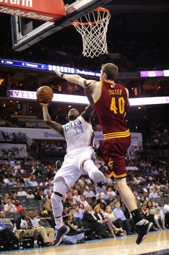 April 17, 2013; Charlotte, NC, USA; Charlotte Bobcats forward Michael Kidd-Gilchrist (14) drives to the basket and scores as he is defended by Cleveland Cavaliers center forward Tyler Zeller (40) during the game at Time Warner Cable Arena. Mandatory Credit: Bobcats win 105-98. Sam Sharpe-USA TODAY Sports