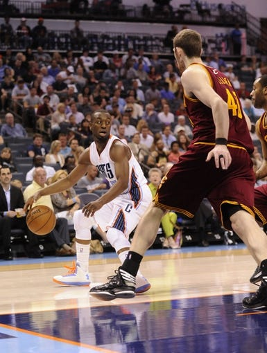 April 17, 2013; Charlotte, NC, USA; Charlotte Bobcats guard Kemba Walker (15) looks to drive past Cleveland Cavaliers center forward Tyler Zeller (40) during the game at Time Warner Cable Arena. Bobcats win 105-98. Mandatory Credit: Sam Sharpe-USA TODAY Sports