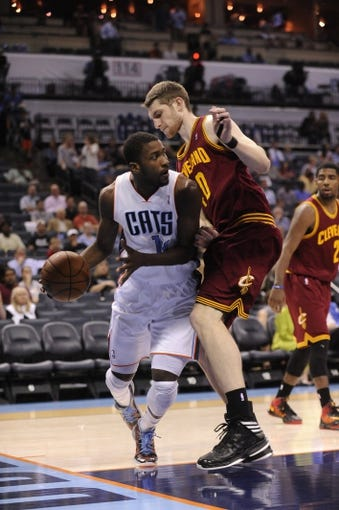 April 17, 2013; Charlotte, NC, USA; Charlotte Bobcats forward Michael Kidd-Gilchrist (14) looks to pass as he is defended by Cleveland Cavaliers center forward Tyler Zeller (40) during the game at Time Warner Cable Arena. Mandatory Credit: Bobcats win 105-98. Sam Sharpe-USA TODAY Sports