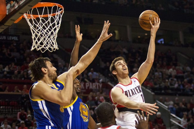 April 17, 2013; Portland, OR, USA; Portland Trail Blazers small forward Victor Claver (18) shoots over Golden State Warriors' defenders in the first half at the Rose Garden.  Mandatory Credit: Jaime Valdez-USA TODAY Sports