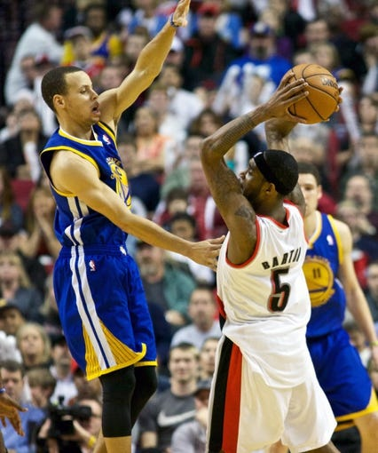 April 17, 2013; Portland, OR, USA; Golden State Warriors point guard Stephen Curry (30) defends Portland Trail Blazers shooting guard Will Barton (5) in the second half at the Rose Garden.  Mandatory Credit: Jaime Valdez-USA TODAY Sports