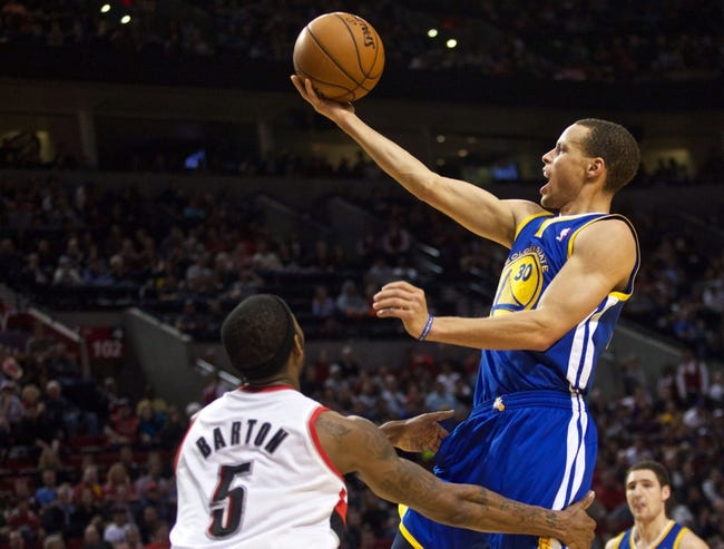 April 17, 2013; Portland, OR, USA; Golden State Warriors point guard Stephen Curry (30) shoots over Portland Trail Blazers shooting guard Will Barton (5) in the second half at the Rose Garden.  Mandatory Credit: Jaime Valdez-USA TODAY Sports