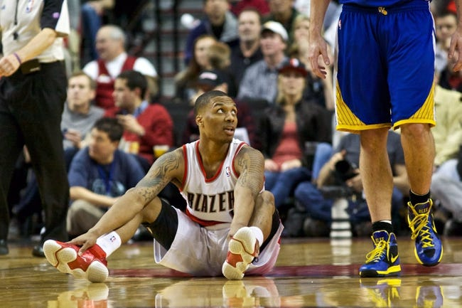 April 17, 2013; Portland, OR, USA; Portland Trail Blazers point guard Damian Lillard (0) reacts against the Golden State Warriors in the second half at the Rose Garden.  Mandatory Credit: Jaime Valdez-USA TODAY Sports